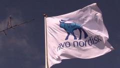 The Novo Nordisk corporate flag Stock Footage