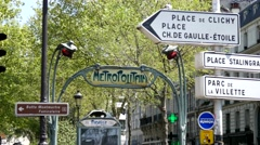 Metropolitain station Pigalle on Montmartre Paris and other pointers - stock footage