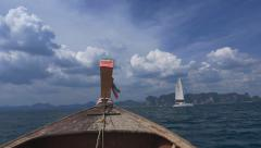 Slow motion of wooden boat going through the island Stock Footage