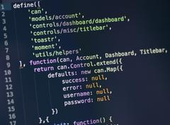 Javascript code on computer screen - stock photo