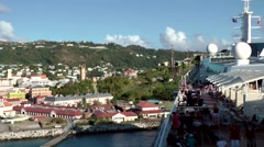 Grenada island Caribbean Sea 056 big cruise ship leaves St. George's city Stock Footage