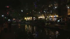 water reflections San Antonio river walk at night 4k - stock footage