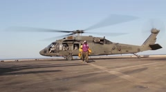 US Army UH-60 Blackhawk On Flight Deck - stock footage