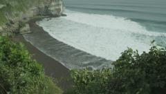 Panorama of rock and big wave in slow motion at Uluwatu, Bali. Red Epic, 4K Stock Footage