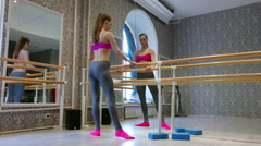 Flexible girl  pole dancer warms up  in training hall.  4K 3840x2160 Stock Footage