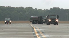 US Airbase Vehicle Traffic On Runway Stock Footage