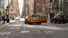 typical New York street view with yellow taxi cabs - stock footage