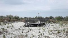 Old wooden pier, desolate beach, sand, pontoon, abandoned jetty, boardwalk Stock Footage