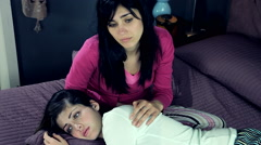 Stock Video Footage of Two sad female friends holding each other in bed
