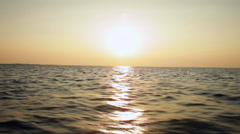 Speed boat sailing the ocean in the sunset at dusk adventure during vacation Stock Footage