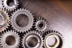 Gears on metal background Stock Photos
