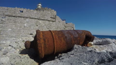 Rusty medieval cannon near Rhodes town port fort. Dodecanese, Greece, 4K Stock Footage