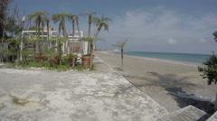 Empty Mediterranean sea beach in Rhodes town. Rhodes island, Greece, 4K Stock Footage