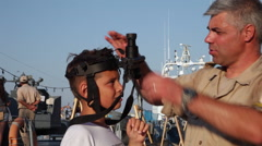 Romanian Navy Day, boy testing night vision scope, soldiers, exhibition Stock Footage
