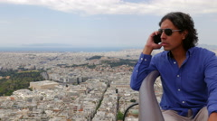 Man Talking On Phone Over Athens, Greece Stock Footage