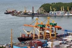 View on ships at the pier and port cranes on seaport Petropavlovsk-Kamchatsky Stock Photos