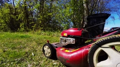Mowing the lawn with a lawn mower Stock Footage