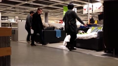 Customer shopping sofa bed inside Ikea store Stock Footage