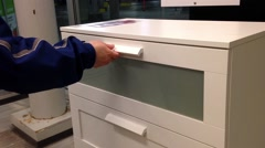 A hand opens a drawer in cabinet Stock Footage