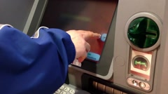 Man hand inserting a bank card to deposit cheque Stock Footage
