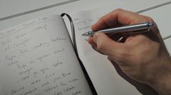 Taking a few notes in my personal idea journal - stock photo