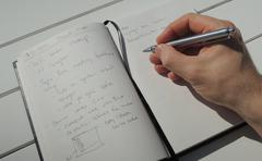Taking a few notes in my personal idea journal Stock Photos
