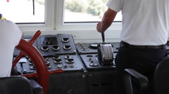 Ship's crew in the control room with speed handle and navigation equipment - stock footage