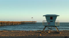 Ocean Pier and Lifeguard Tower Stock Footage