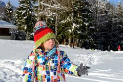 Little 3 year old child playing in the snow Stock Photos