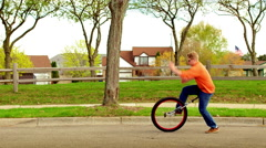Young man riding a unicycle in the Mid West 4K - stock footage