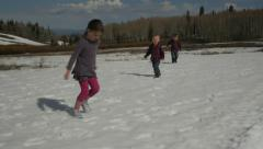 Little kids running in the snow Stock Footage