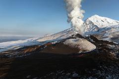 Volcanic landscape: beautiful eruption volcano. Kamchatka Peninsula, Far East - stock photo