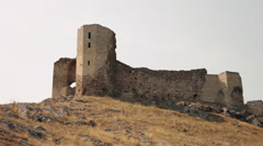Keep, old medieval castle, ruins on hill, sunset, beautiful landscape,watchtower Stock Footage
