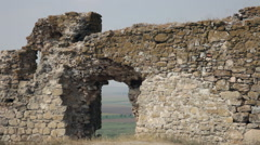 Archway in ruined fortress with antique brick wall fortifications Stock Footage