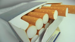 A pack of cigarettes on a white background Stock Footage