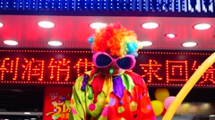 Jade jewelry store promotions, clowns and balloons to attract people Stock Footage