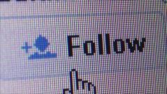 Social Media Macro: User Clicks Twitter 'Follow' Button Stock Footage