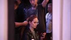 Hairdressers style super model for Haute Couture catwalk in backstage - stock footage