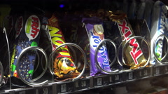Nestle Lion candy bar coming out of German vending machine 4k Stock Footage