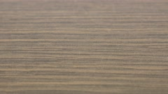 Plywood close-up wood grain texture 4K 2160p UHD footage - Panning over p Stock Footage