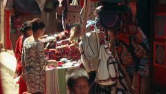 Shopkeepers prepare shop, Bhaktapur, Nepal Stock Footage