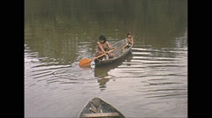 Vintage 16mm film,  Amazon dug out canoe goes down river, 1960s Stock Footage