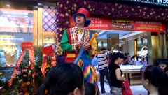 Jade jewelry store promotions, clowns and balloons to attract people - stock footage