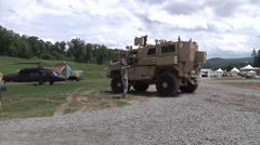 US Military Armored Personnel Carrier On Street Stock Footage