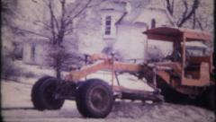 2008 - road grader plows snow in residential area - vintage film home movie Stock Footage