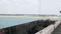 Floating crane barge coal loading Stock Footage