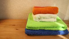 Four clean towels folded on a table panning Stock Footage