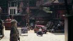Children climb Nyatpola Temple in Bhaktapur, Nepal Stock Footage