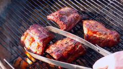 Grilling Ribs on Old Fashioned Charcoal Grill, Sunny Day - stock footage