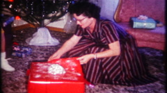 2006 - woman gets a hair dryer on Christmas morning - vintage film home movie Stock Footage
